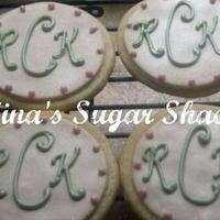 "Rck Monogram Cookies 3"" round vanilla sugar cookies (modified NFSC) with fondant and royal icing for the monograms sprayed with pearl airbrush spray for..."