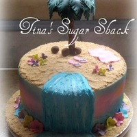 "Luau Cake 9"" round iced in buttercream with fondant palm tree and flowers, flip-flops,etc. TFL"