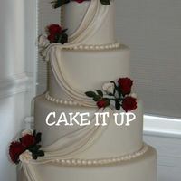 """simply Ivory""   Fondant covered, w/ GP roses and pearlized drapes."