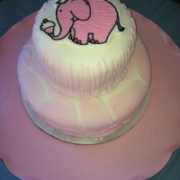 Safari Pink Elephant I made this cake for my neice's first birthday. The bottom tier is covered in fondant with pink giraffe accents. The top tier is the...