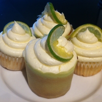 Margarita Cupcakes  Just made these for fun when friends came over. Lime and tequila-flavoured cupcakes, brushed with tequila after taking out of oven, topped...