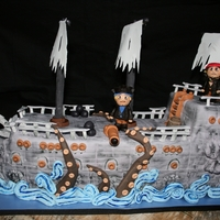 Pirates Of The Caribbean This is the Ghost Ship from Pirates of the Caribbean. It was for a little boy turing eight. He wanted him and Jack Sparrow fighting a...