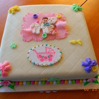 Girl Baby Shower Cake Butter cake with buttercream fondant. All decorations made out of fondant.