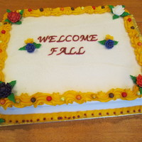 Welcome Fall Cake This is a White almond sour cream cake with pineapple filling.Buttercream icing and reverse shell borders. Royal icing flowers and leaves...