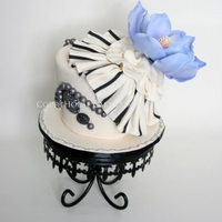 Vintage Striped Ruffles And Periwinkle Colour Magnolia   This was a black and ivory striped ruffle with a periwinkle colour magnolia. Pewter pearls and jewels to give a vintage feel