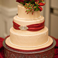 Pale Gold Shimmering Cake With Claret Roses And Hypericum Berries And And Claret Sash And Broach To Match The Brides Hair Beautiful Holida... Pale Gold shimmering cake with Claret Roses and Hypericum Berries and and Claret Sash and Broach to match the Brides hair. Beautiful...