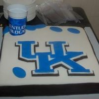 University Of Kentucky Fan fondant logo; rope corners; fondant footballs; groom proposed at UK football game; significance of cup: brides stadium cup covered groom&#...