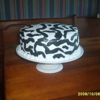 Zebra French Vanilla Cake with Butter Cream Icing, strawberry filling.