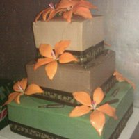 Camouflage Themed Wedding Cake. Camouflage themed cake. Three layer cake with buttercream frosting. Sugarpaste lilies, and chocolate molded bullets.