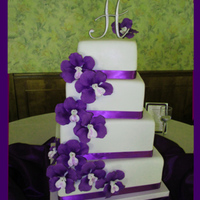 Purple Vanda Sugar Orchids Wedding Cake. Photo makes cake look tilted to the right. It really was very level. :-)