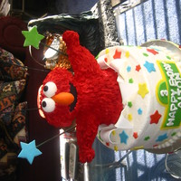 Elmo Cake Elmo themed cake. Elmo is made of RC treats covered in RI. You can't believe how heavy RC and RI gets, or maybe you can. Anyway, it...