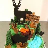 "Hunting This cake is a double layer 8"" round yellow cake with buttercream icing with a camouflage pattern ""starred"" on the side of..."