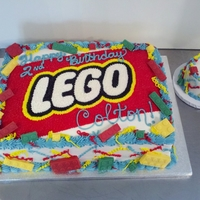 "Lego Double layer marble cake inside, french vanilla buttercream, lego logo starred in, choc legos, and a 4"" round smash cake."