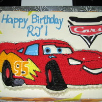 "Lightning Mcqueen Lightning McQueen character cake on an 11""x15"" slab. Cars Cricut cartridge used for the Cars logo and the flames and lightning..."