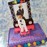 Justin Bieber! sheet cake iced in buttercream with fondant stars. The stage is covered in fondant the background is foam core decorated with fondant. The...