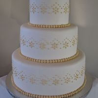Off White And Taupe All buttercream cake the pattern was from the invitations for the wedding. Thank you for looking :)