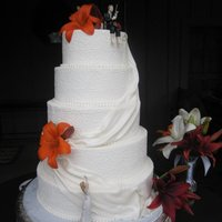 "Olivia  16"",14"",12"",10"",8"" buttercream frosted with fresh flowers fondant drape/sash.. I used an impression mat I..."