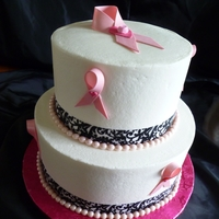 "Breast Cancer Awarness Fundraiser Cake   Buttercream frosted 8"" 6"" with damask ribbon and fondant pearls.. I made the pink ribbons with gumpaste and pearl dusted.."
