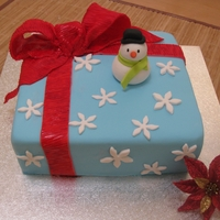 Christmas Cake With Snowman   Fruitcake covered in fondant and snowman made with gumpaste for my wonderful family. Thanks for looking.