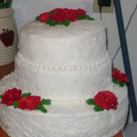 1St Wedding Cake sponged icing with red roses