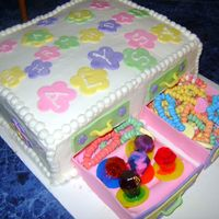 Jewlry Box Cake   Icing is buttercream, decorations are in fondant and gumpaste, with candy ring pops and candy bracelets