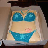 Bikini Cake Done for a 14 year old, a bikini cake done with a star tip all in buttercream icing, even added the birthday boys name into a tattoo