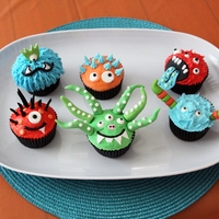 Silly Monster Cupcakes For my son's 2nd birthday party. A few inspired by Better Homes online and a few creations of mine. Iced with buttercream and accented...