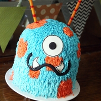 "Furry Monster For my son's second birthday to go with his cupcakes. 2 6"" rounds and half of a small sports ball pan. TFL!"