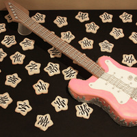 Pink Electric Guitar  Chocolate cake with buttercream and fondant. Sugar cookies iced in zebra pattern. I wish I had more time to work on the neck of the guitar...