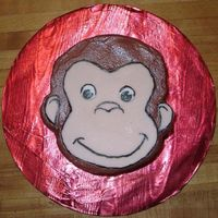 "Curious George Smash Cake This was done to match Curious George With Balloons. Carved from a 6"" round cake. His face and ears are fondant and the features are..."