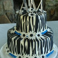 Zebra This was a 2 day notice wedding cake(she picked the stripe cake) as we were in the tornado area of Al. Bridesmaid dresses were blue. She...