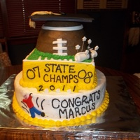 2011 Graduation / Football Themed Cake  This cake was made out of all buttercream icing with fondant accents. It was so fun to make. It was a friend of mines son. Our football...