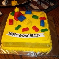 Lego Birthday Cake Made out of white cake with Lemon icing, and all lego pieces and lego man are made out of fondant.