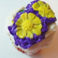 Spring Beckons.. Thawing From The Deep Freeze Daisy Cupcake Pot Used 3d daisy flower mold from here http://www.sweetdecorations.com/store/c11/floral_molds.html Purple and yellow fondant by Sweet Dekor,...
