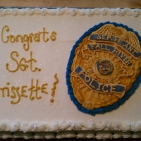 1334937566.jpg This was done for a good friend of ours that just made Seargeant on the local police force. The badge is fondant with buttercream accents...