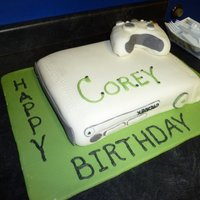 X-Box Cake My son's 10th birthday cake. Covered in MMF. The controller is made of rice krispy treats. His friends loved it!