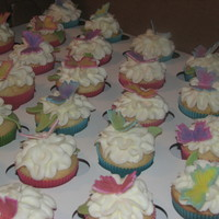 1315766205.jpg Made 400 cupcakes for a wedding. Buttercream icing with fondant butterflies.