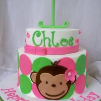 Pink Mod Monkey Cake Buttercream with fondant accents.