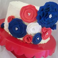 4Th Of July Flowers Buttercream cake with gumpaste flowers. The flowers are based on a cake that was posted here about a week ago, just different colors. Not...