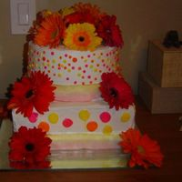 Gerbera Daisy Wedding Cake  This is a 10 inch square and 8 inch round lemon cake with lemon mousse filling and bettercreme frosting. I wasn't really happy with...