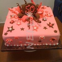 Birthday Cake, Pink And Brown Pink and brown cake, covered with buttercream. Gumpaste decorations.