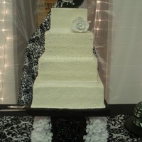 White Damask Cake The bride wanted the damask to be white on white for this cake. I really liked the outcome of it. Very sutle but elegant. TFL!