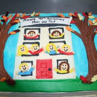 House Cake This cake was done for a 40th anniversary. They wanted the parents and all six kids hanging out of the windows of their three story home. I...