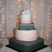 Faded Color Wedding Cake The bride wanted the colors on this to fade up on the tiers. the round tiers are done with fondant and has a ruffled look. The square tiers...