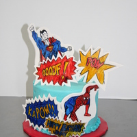 Handpainted Superhero Cake Handpainted guympaste plaques on buttercream cake. This cake was a lot of fun to do!