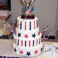Stars And Stripes 3 tier cake, covered in buttercream with fondant stars and stripes. Thecake was auctioned off at a cake auction for the high school ($800)...