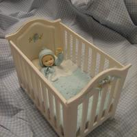 "Classic Crib The crib was done out of pastillage using a set of cutters. For the baby's face, I've used a mold and gumpaste. The ""..."