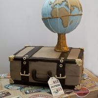Travel Cake Thanks to my father in law, the globe actually turned. All decorations on suitcase and cake are fondant.