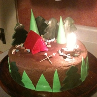 Camping Themed Birthday Cake Chocolate buttercream with fondant, gumpaste, and chocolate accents. Real campfire created by placing candles together and hiding them with...