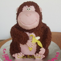 3D Gorilla/monkey Carved cake and RKT head. Fondant accents. Covered in chocolate buttercream.